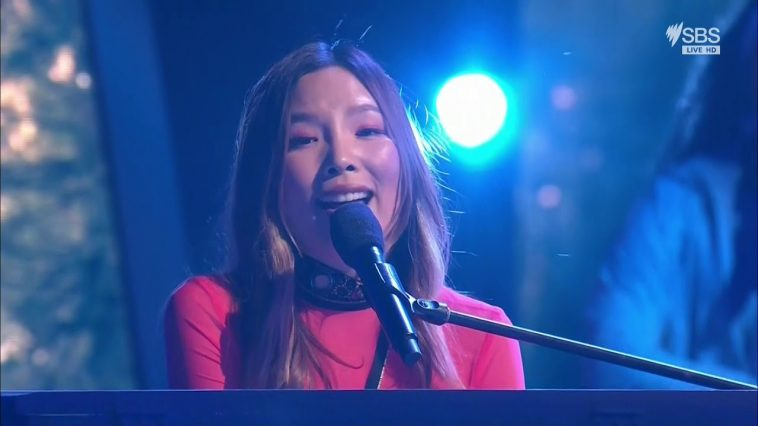 """Dami Im performing """"Marching On"""" behind a piano at Eurovision - Australia Decides"""