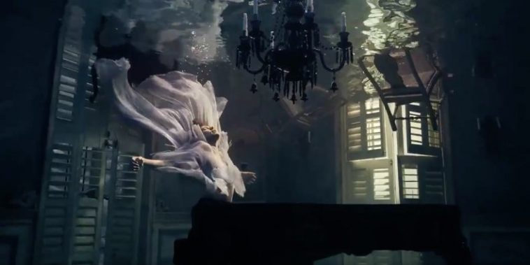 """Harry Styles at the piano with two ghosts in his music video for """"Falling"""""""
