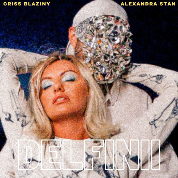 """Single artwork for """"Delfinii"""" with Alexandra Stan wearing white, leaning back with her arms wrapped around Criss Blaziny's shoulders who is also wearing white with a diamante facial mask."""