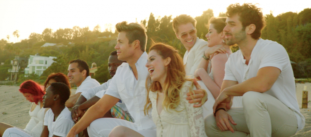 Photo of the cast of Tell Me I Love You on the beach.