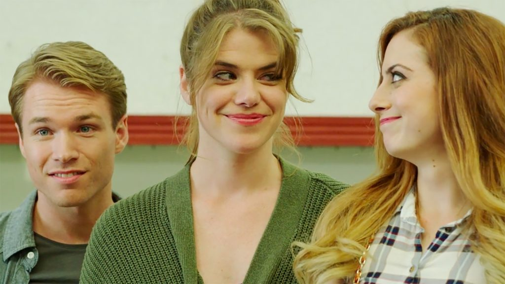 Still from the Tell Me I Love You film showing Ben, Melanie, and Ally, played by Sam Clark, Kaniehtiio Horn, and Paulina Cerrilla, respectively.