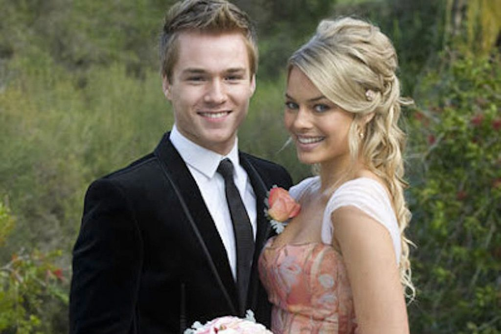 Sam Clark as Ringo Brown and Margot Robbie as Donna Freedman at their wedding in the Australian soap, Neighbours.