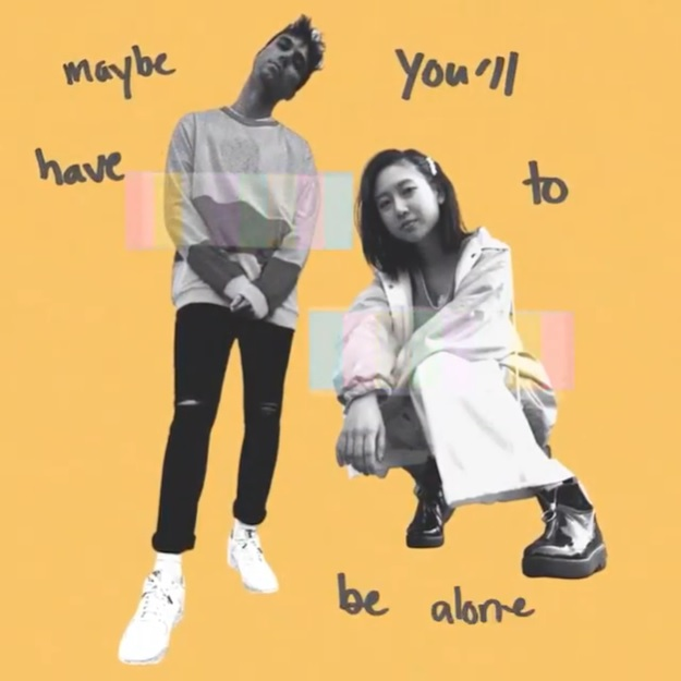 """Yellow image displaying some of the lyrics from """"Change"""" with Troy Ogletree standing in the middle and ÊMIA is crouching."""