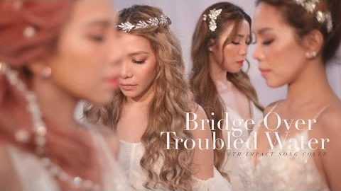 """YouTube thumbnail of the video of """"Bridge Over Troubled Water"""" which sees the 4th Impact girls looking like goddesses, dressed all in white."""