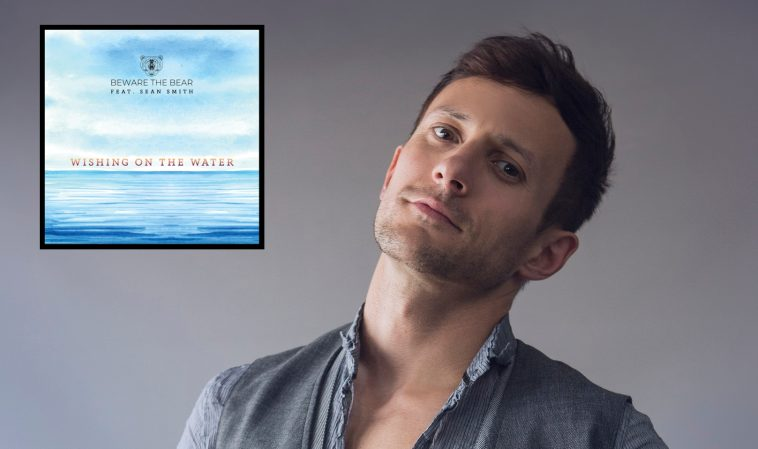 """Sean Smith with his head tilted back and the single artwork in the top left which is blue and has the title """"Wishing On The Water""""."""