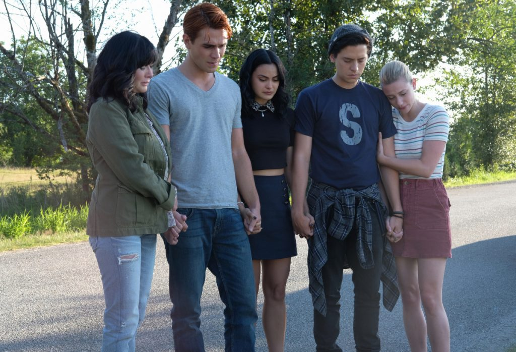 "Riverdale -- ""Chapter Fifty-Eight: In Memoriam"" -- Image Number: RVD401a_0113.jpg -- Pictured (L-R): Shannen Doherty, KJ Apa as Archie, Camila Mendes as Veronica, Cole Sprouse as Jughead and Lili Reinhart as Betty -- Photo: Robert Falconer/The CW -- © 2019 The CW Network, LLC. All Rights Reserved."